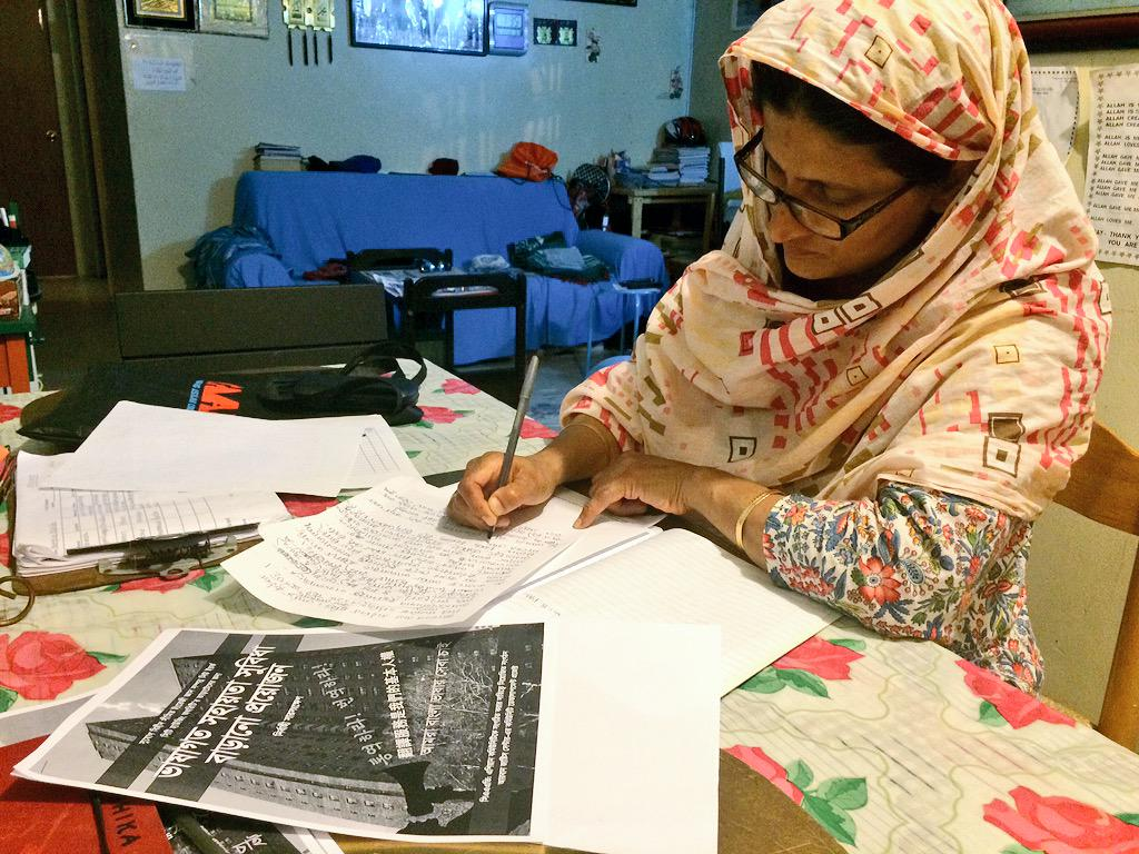 Bengali NYCHA leader Nayrin Apa preparing statements for a press conference.