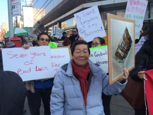 Tenant leader Ms. Song marching for tenant safety and affordable housing